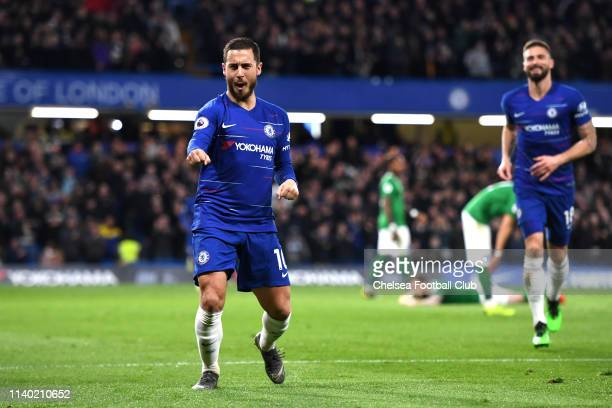Eden Hazard of Chelsea celebrates after scoring his team's second goal during the Premier League match between Chelsea FC and Brighton Hove Albion at...
