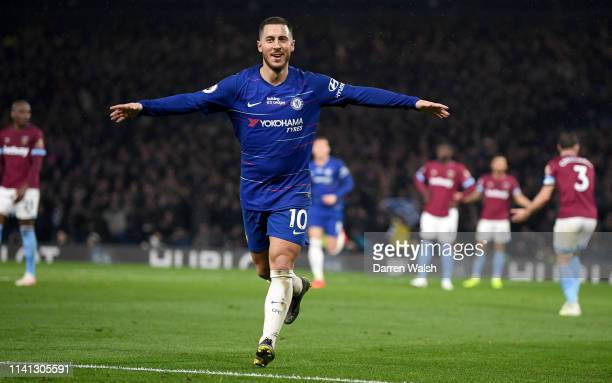 Eden Hazard of Chelsea celebrates after scoring his team's second goal during the Premier League match between Chelsea FC and West Ham United at...