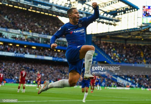 Eden Hazard of Chelsea celebrates after scoring the opening goal during the Premier League match between Chelsea FC and Liverpool FC at Stamford...