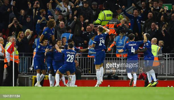 Eden Hazard of Chelsea celebrates after scoring the second and winning goal during the Carabao Cup Third Round match between Liverpool and Chelsea at...
