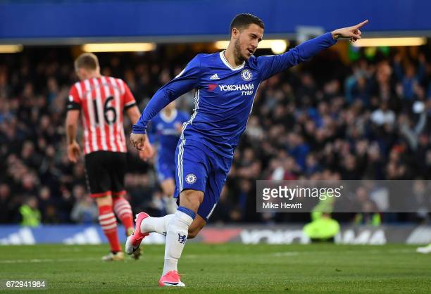 Eden Hazard of Chelsea celebrates as he scores their first goal during the Premier League match between Chelsea and Southampton at Stamford Bridge on...