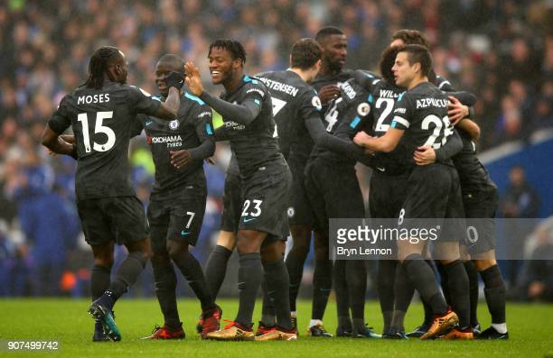Eden Hazard of Chelsea celebrates as he scores their first goal with team mates during the Premier League match between Brighton and Hove Albion and...