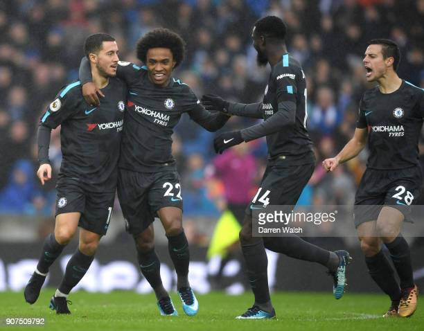 Eden Hazard of Chelsea celebrates as he scores their first goal with team mate Willian during the Premier League match between Brighton and Hove...