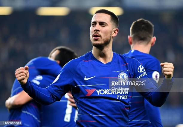Eden Hazard of Chelsea celebrates as Pedro of Chelsea scores their first goal during the Premier League match between Chelsea FC and Tottenham...