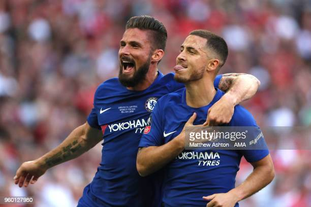 Eden Hazard of Chelsea celebrates scoring a goal to make the score 10 with Olivier Giroud during the Emirates FA Cup Final between Chelsea and...