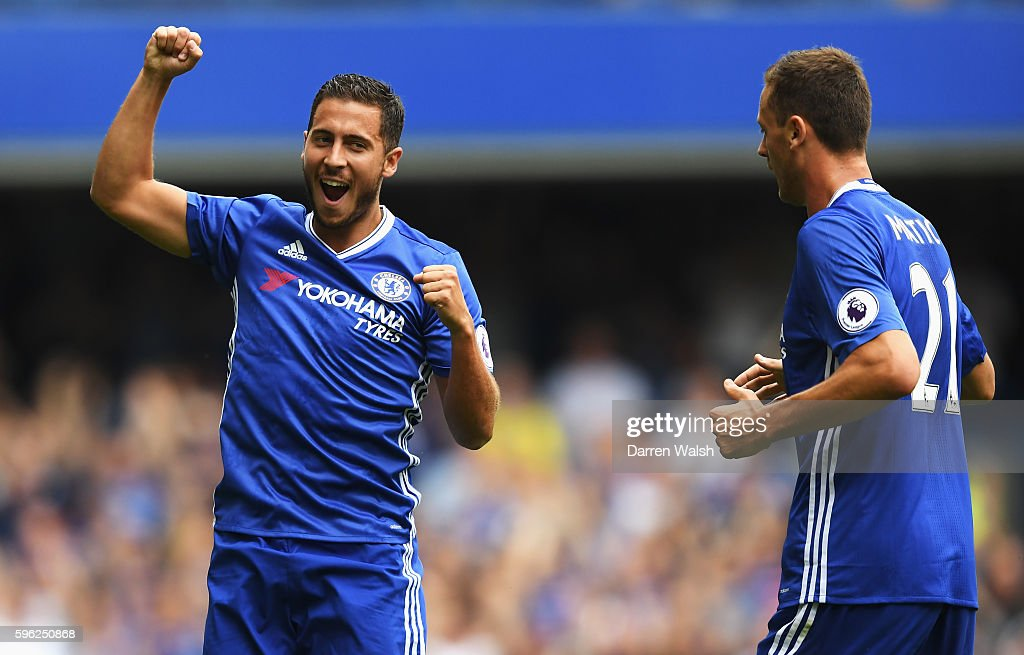 Eden Hazard of Chelsea celebrates scoring his sides first goal with his team mate Nemanja Matic of Chelsea during the Premier League match between Chelsea and Burnley at Stamford Bridge on August 27, 2016 in London, England.