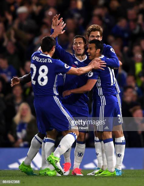 Eden Hazard of Chelsea celebrates scoring his sides first goal with his Chelsea team mates during the Premier League match between Chelsea and...