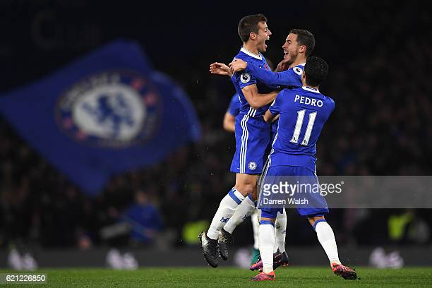 Eden Hazard of Chelsea celebrates scoring his sides fourth goal with Cesar Azpilicueta of Chelsea and Pedro of Chelsea during the Premier League...