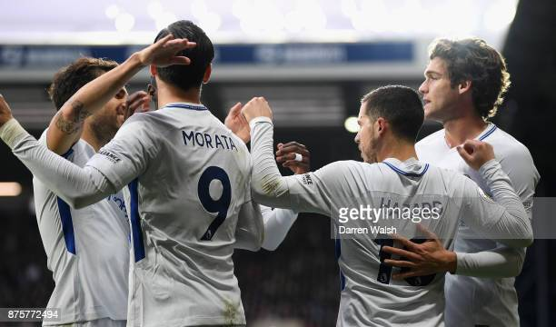 Eden Hazard of Chelsea celebrates scoring his side's second goal with his team mates during the Premier League match between West Bromwich Albion and...