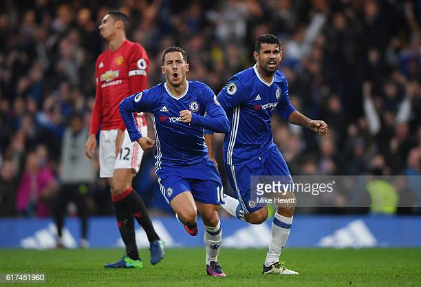 Eden Hazard of Chelsea celebrates scoring his sides third goal with Diego Costa of Chelsea during the Premier League match between Chelsea and...