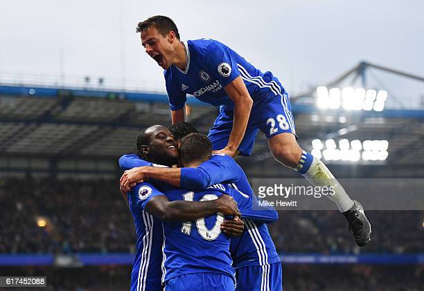 Eden Hazard of Chelsea celebrates scoring his sides third goal with his team mates during the Premier League match between Chelsea and Manchester...