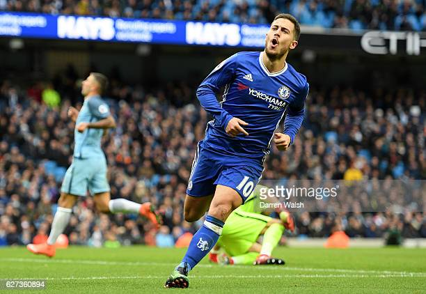 Eden Hazard of Chelsea celebrates scoring his team's third goal during the Premier League match between Manchester City and Chelsea at Etihad Stadium...