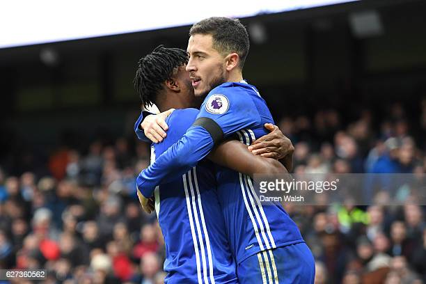 Eden Hazard of Chelsea celebrates scoring his team's third goal with his team mate Nathaniel Chalobah during the Premier League match between...