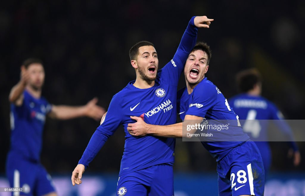 Eden Hazard of Chelsea celebrates scoring the first Chelsea goal with Cesar Azpilicueta during the Premier League match between Watford and Chelsea at Vicarage Road on February 5, 2018 in Watford, England.