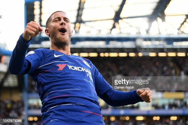 Eden Hazard of Chelsea celebrates scoring the opening goal during the Premier League match between Chelsea FC and Liverpool FC at Stamford Bridge on...