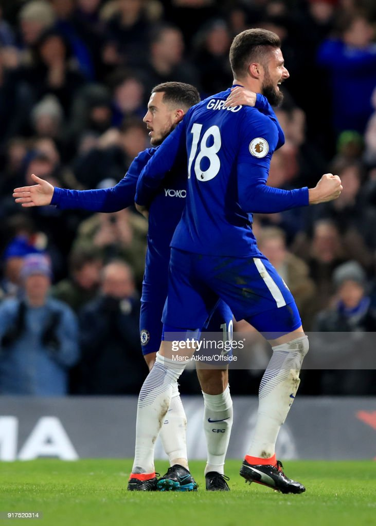 Eden Hazard of Chelsea celebrates scoring the opening goal with Olivier Giroud during the Premier League match between Chelsea and West Bromwich Albion at Stamford Bridge on February 12, 2018 in London, England.