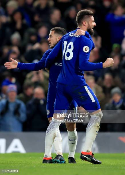 Eden Hazard of Chelsea celebrates scoring the opening goal with Olivier Giroud during the Premier League match between Chelsea and West Bromwich...