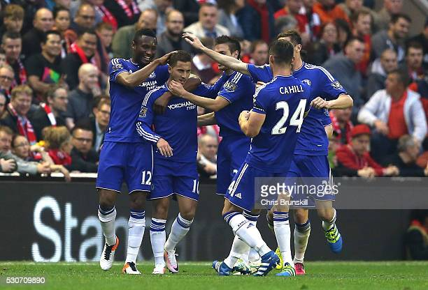 Eden Hazard of Chelsea celebrates scoring the opening goal with team mates during the Barclays Premier League match between Liverpool and Chelsea at...