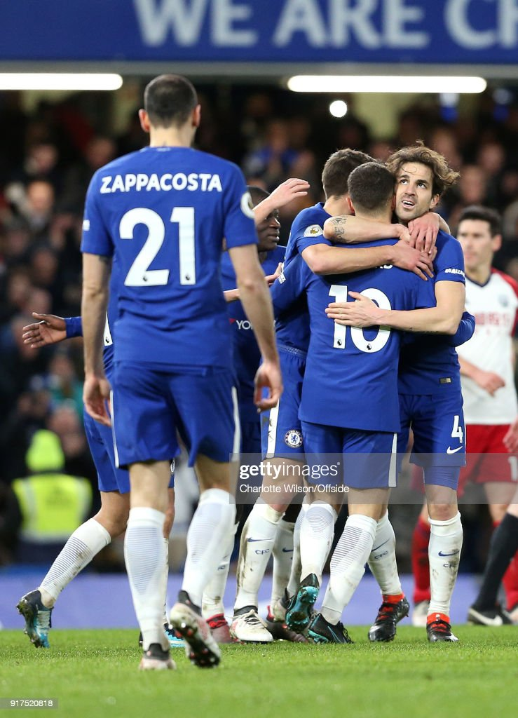 Eden Hazard of Chelsea (10) celebrates scoring their 3rd goal with Cesc Fabregas of Chelsea and the rest of the team during the Premier League match between Chelsea and West Bromwich Albion at Stamford Bridge on February 12, 2018 in London, England.