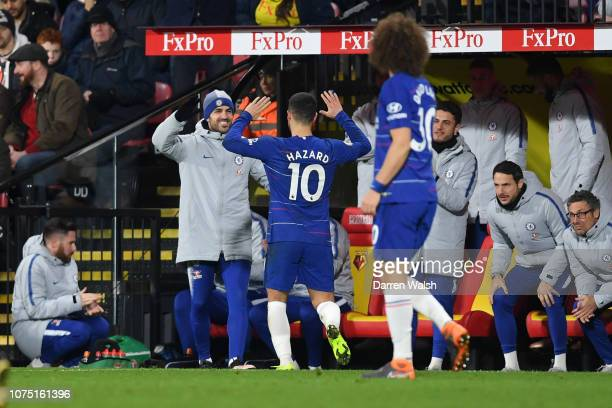 Eden Hazard of Chelsea celebrates with Cesc Fabregas of Chelsea at the bench after scoring their team's first goal during the Premier League match...