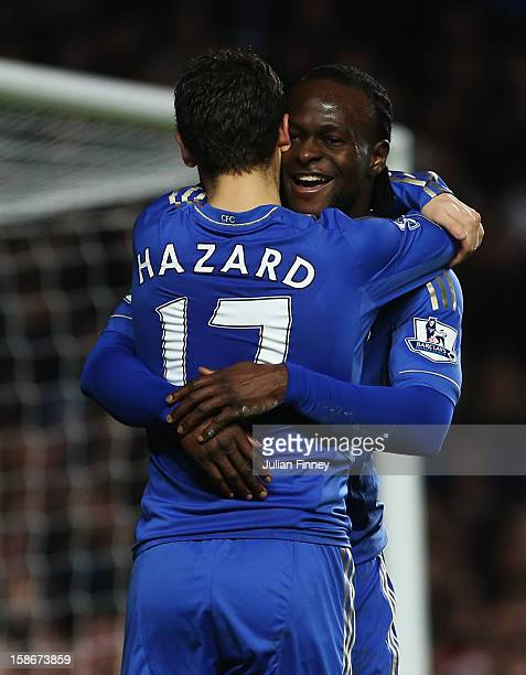 Eden Hazard of Chelsea celebrates with David Luiz as he scores their seventh goal during the Barclays Premier League match between Chelsea and Aston...