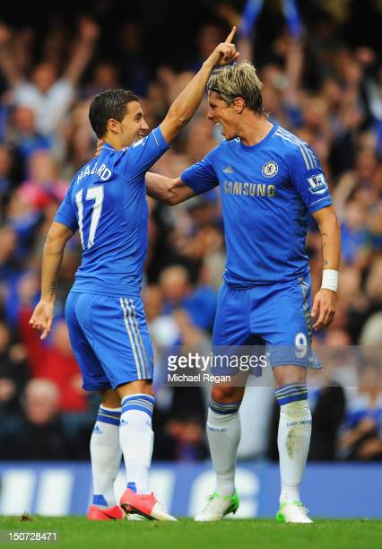 Eden Hazard of Chelsea celebrates with Fernando Torres as he scores their first goal from the penalty spot during the Barclays Premier League match...