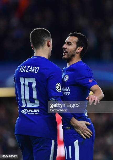 Eden Hazard of Chelsea celebrates with Pedro of Chelsea after his shot was deflected in by Stefan Savic of Atletico Madrid for Chelsea's first goal...