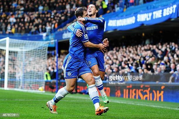 Eden Hazard of Chelsea celebrates with team mate Branislav Ivanovic after scoring during the Barclays Premier League match between Cheslea and...