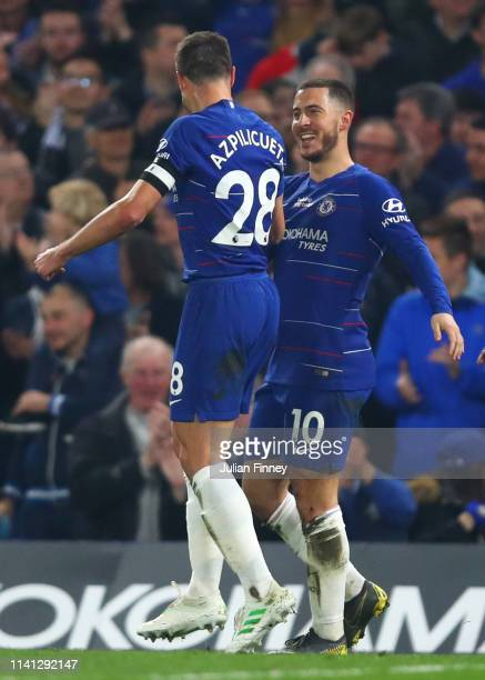 Eden Hazard of Chelsea celebrates with team mate Cesar Azpilicueta as he scores his team's first goal during the Premier League match between Chelsea...