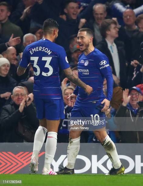 Eden Hazard of Chelsea celebrates with team mate Emerson as he scores his team's first goal during the Premier League match between Chelsea FC and...