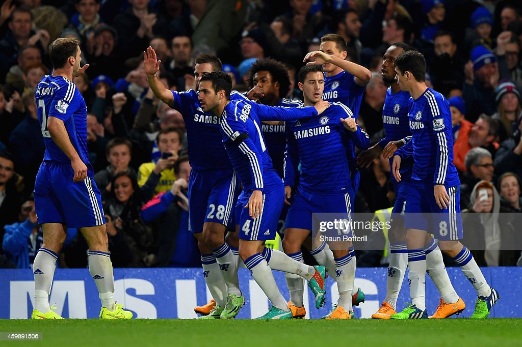 Eden Hazard of Chelsea celebrates with team mates after scoring the opening goal during the Barclays Premier League match between Chelsea and Tottenham Hotspur at Stamford Bridge on December 3, 2014 in London, England.