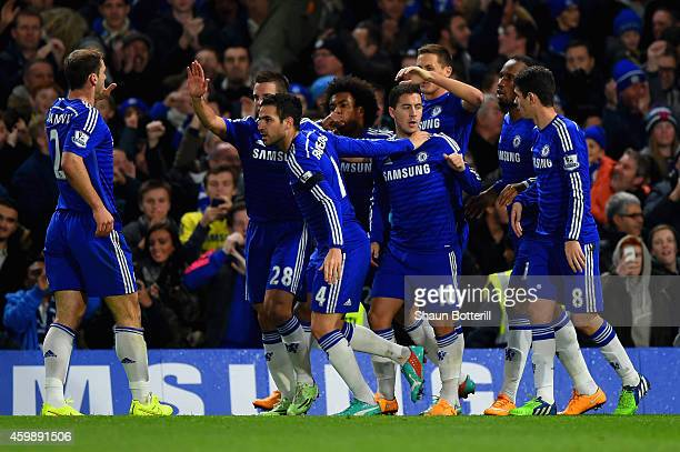 Eden Hazard of Chelsea celebrates with team mates after scoring the opening goal during the Barclays Premier League match between Chelsea and...