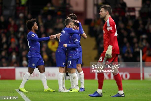 Eden Hazard of Chelsea celebrates with team mates after scoring their team's second goal from the penalty spot during the Premier League match...