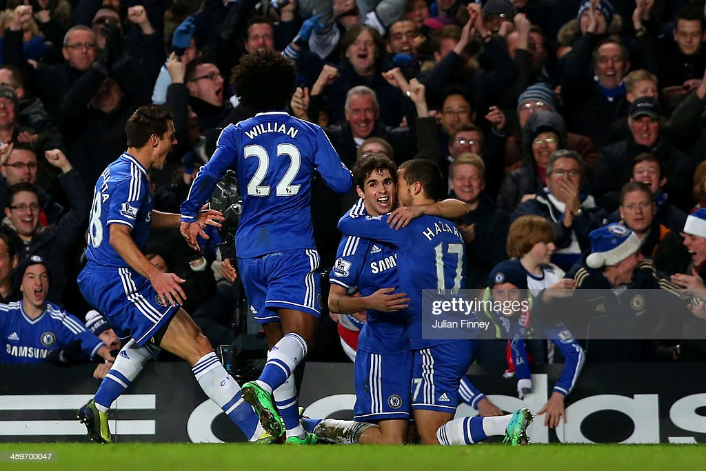 Eden Hazard (2nd R) of Chelsea celebrates with teamates after scoring a goal to level the scores at 1-1 during the Barclays Premier League match between Chelsea and Liverpool at Stamford Bridge on December 29, 2013 in London, England.