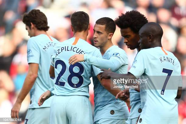 Eden Hazard of Chelsea celebrates with teammate Cesar Azpilicueta after scoring his team's first goal during the Premier League match between...