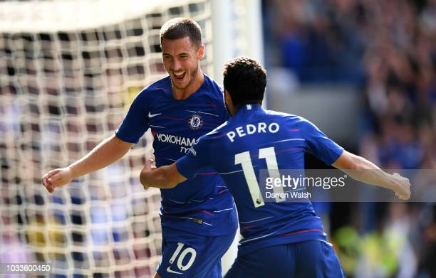 Eden Hazard of Chelsea celebrates with teammate Pedro after scoring his team's second goal during the Premier League match between Chelsea FC and...