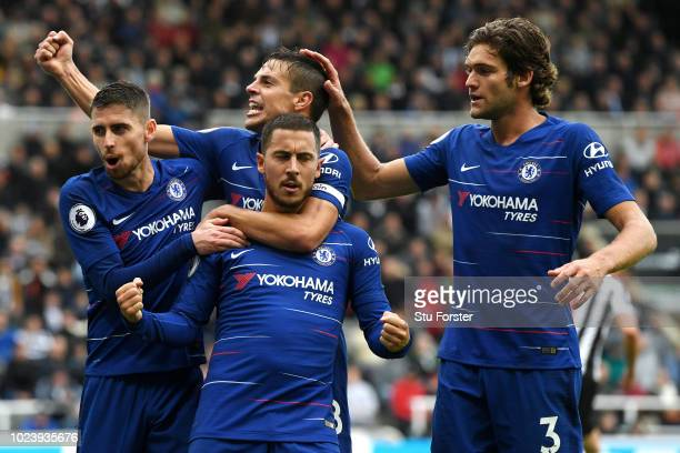 Eden Hazard of Chelsea celebrates with teammates after scoring a penalty for his team's first goal during the Premier League match between Newcastle...