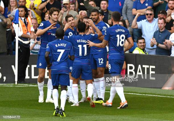 Eden Hazard of Chelsea celebrates with teammates after scoring his team's second goal during the Premier League match between Chelsea FC and AFC...
