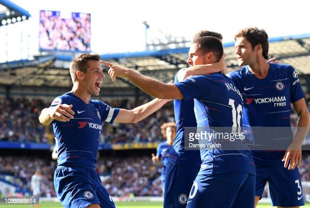 Eden Hazard of Chelsea celebrates with teammates after scoring his team's second goal during the Premier League match between Chelsea FC and Cardiff...