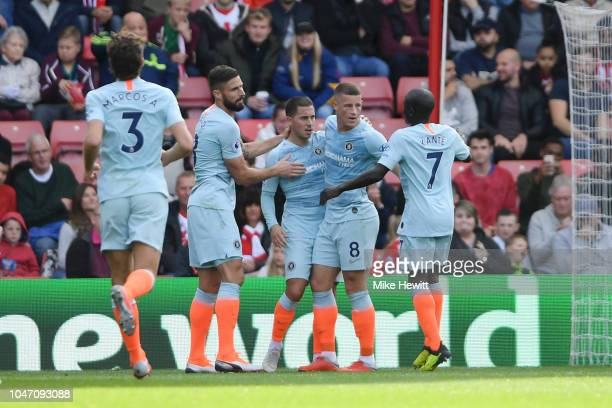 Eden Hazard of Chelsea celebrates with teammates after scoring his team's first goal during the Premier League match between Southampton FC and...