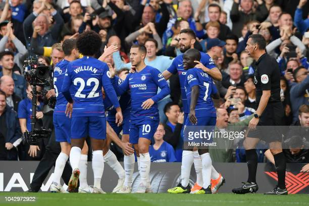 Eden Hazard of Chelsea celebrates with teammates after scoring the opening goal during the Premier League match between Chelsea FC and Liverpool FC...