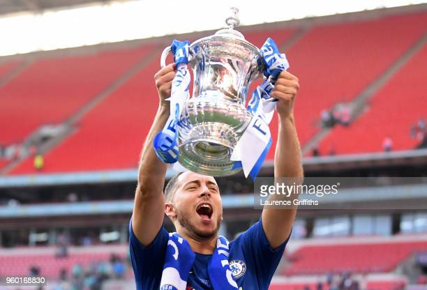 Eden Hazard of Chelsea celebrates with the Emirates FA Cup Trophy following his sides victory in The Emirates FA Cup Final between Chelsea and...