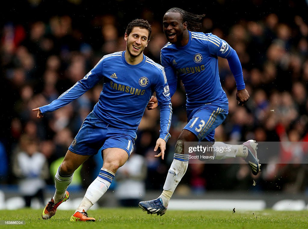 Eden Hazard of Chelsea (L) celebrates with Victor Moses after scoring their second goal during the Barclays Premier League match between Chelsea and West Ham United at Stamford Bridge on March 17, 2013 in London, England.