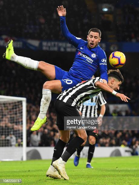 Eden Hazard of Chelsea collides with Ayoze Perez of Newcastle United during the Premier League match between Chelsea FC and Newcastle United at...