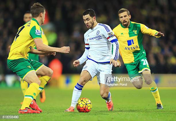 Eden Hazard of Chelsea competes for the ball against Ryan Bennett and Gary O'Neil of Norwich City during the Barclays Premier League match between...