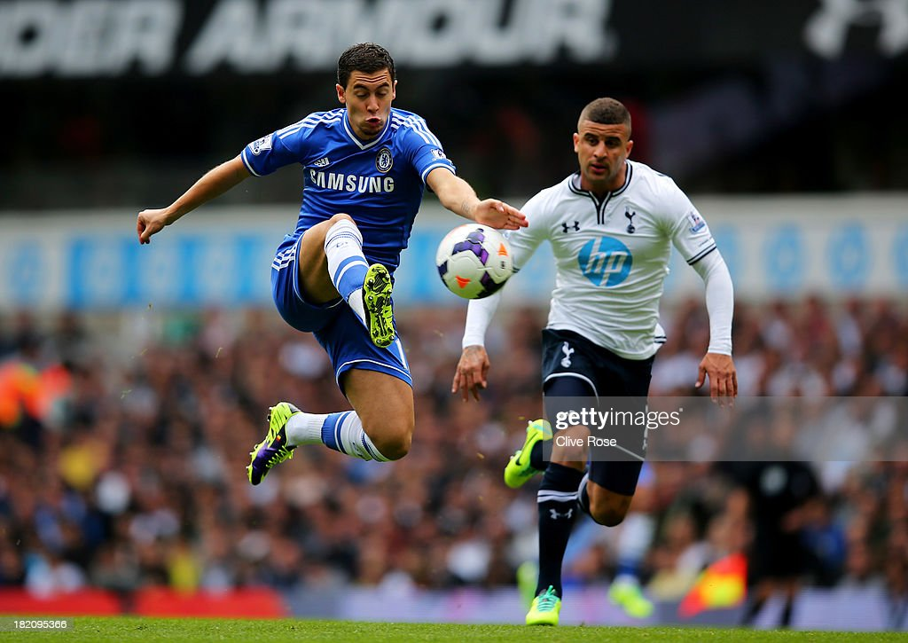 Eden Hazard of Chelsea controls the ball ahead of Kyle Walker of Tottenham Hotspur during the Barclays Premier League match between Tottenham Hotspur and Chelsea at White Hart Lane on September 28, 2013 in London, England.
