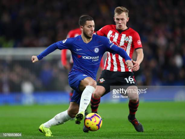 Eden Hazard of Chelsea controls the ball as James WardProwse of Southampton looks on during the Premier League match between Chelsea FC and...