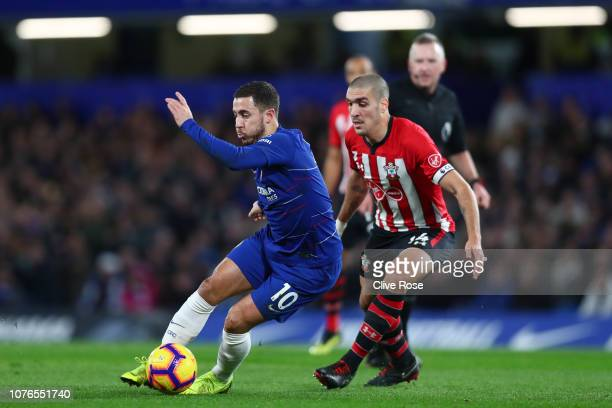 Eden Hazard of Chelsea controls the ball as Oriol Romeu of Southampton looks on during the Premier League match between Chelsea FC and Southampton FC...