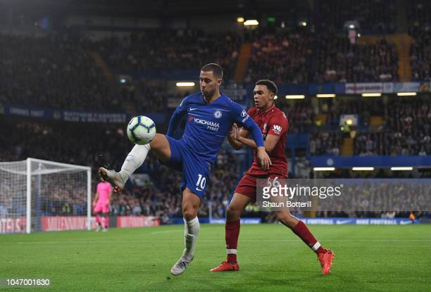 Eden Hazard of Chelsea controls the ball as Trent AlexanderArnold of Liverpool challenges during the Premier League match between Chelsea FC and...