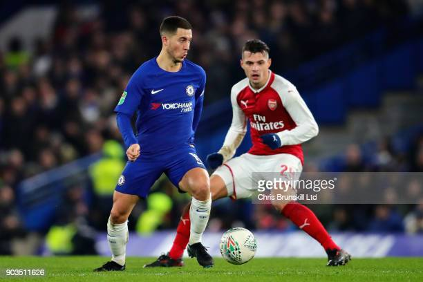 Eden Hazard of Chelsea controls the ball away from Granit Xhaka of Arsenal during the Carabao Cup SemiFinal First Leg match between Chelsea and...